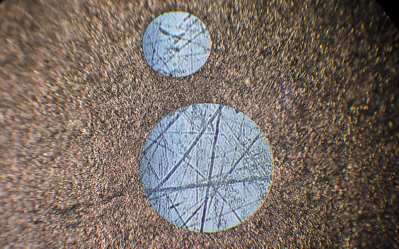 Holes cut by laser in tungsten (0.5 and 0.3 mm diameters)